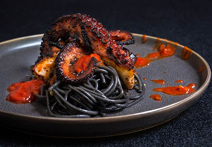 Squid Ink Spaghetti Grilled octopus over s...