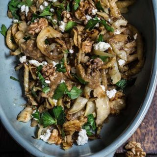 Caramelized fennel with roasted garlic lemon vinaigrette {goat cheese + walnuts}